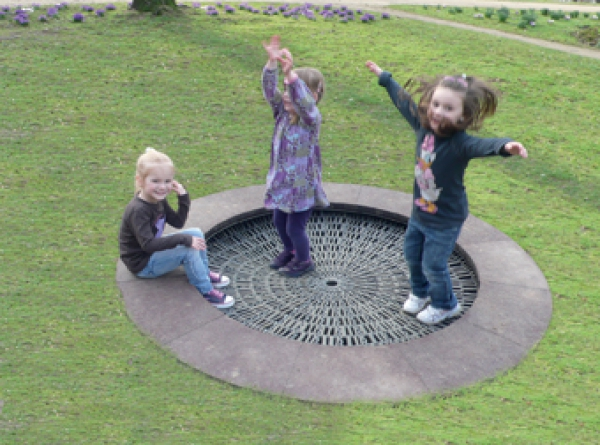 Children bouncing on a trampoline